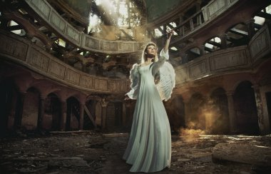 Beautiful angel in old, abandon place