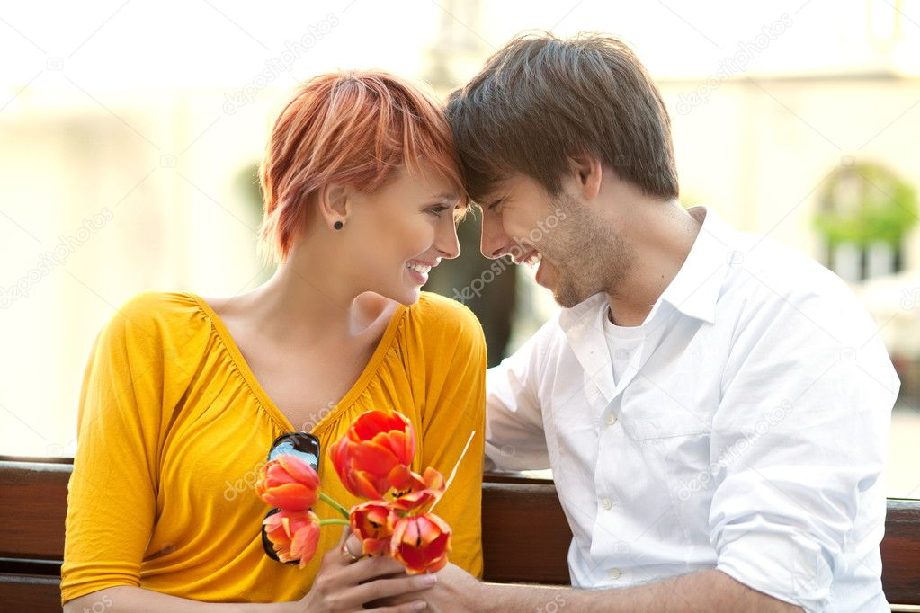 Closeup portrait of a happy young couple looking at each other