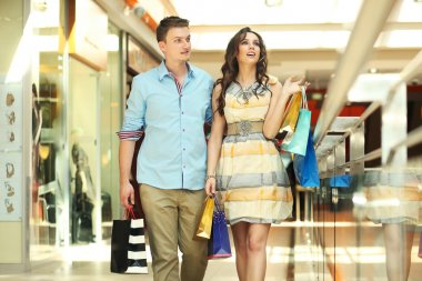 Pair of young in a shopping center
