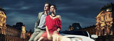 Colorful image of beautiful couple sitting in a limousine
