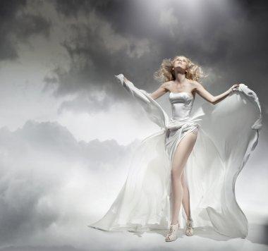 Romantic blond beauty posing in amazing dress
