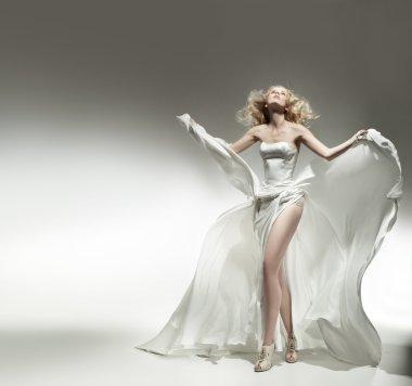 Romantic blonde beauty wearing white dress