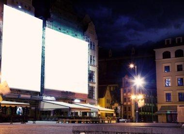 Empty white board over city night background