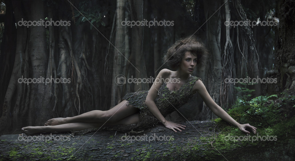 Eco woman lying on the trunk