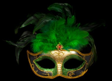 Green Venetian mask on black