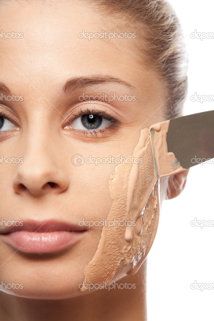 Putting on makeup foundation with spatula on a face - isolated on white — Photo by ...
