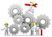 Arbeiterteam mit Getriebemechanismus