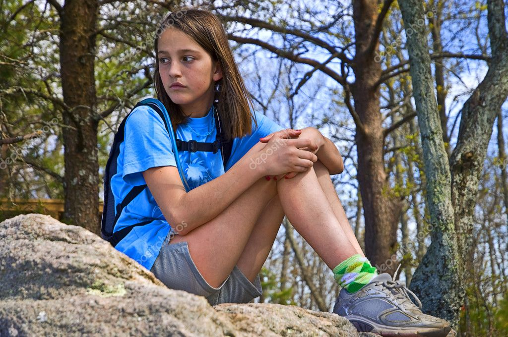 Preteen Girl Sitting Outdoors
