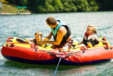 Family Fun Tubing on a Lake