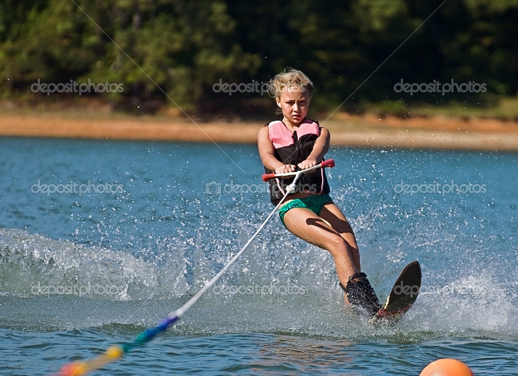Young Girl Slalom Skiing
