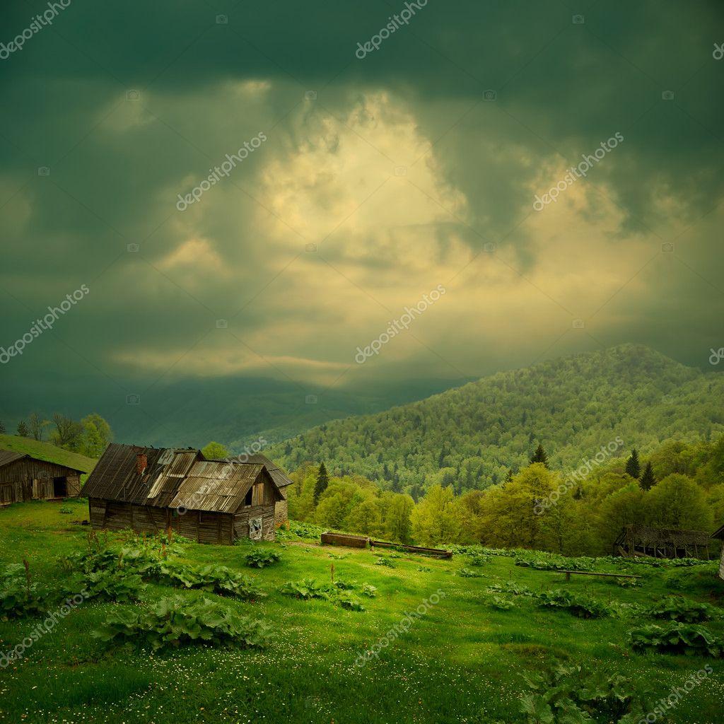 Фотообои Mystery mountain landscape. Ray of light in dark clouds