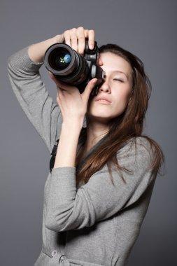 Beautiful woman photographer with camera