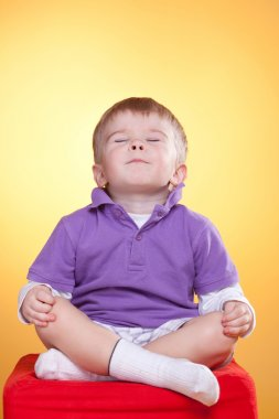 Cute child happy in meditation