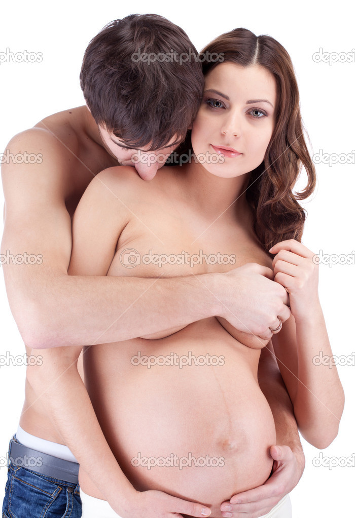 Woman kissing mans stomach