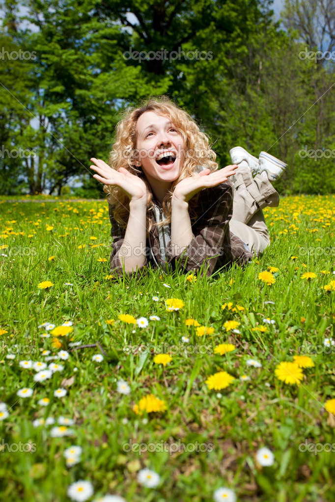 Happy surprised woman on flower field