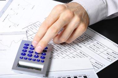 Hand working on the calculator