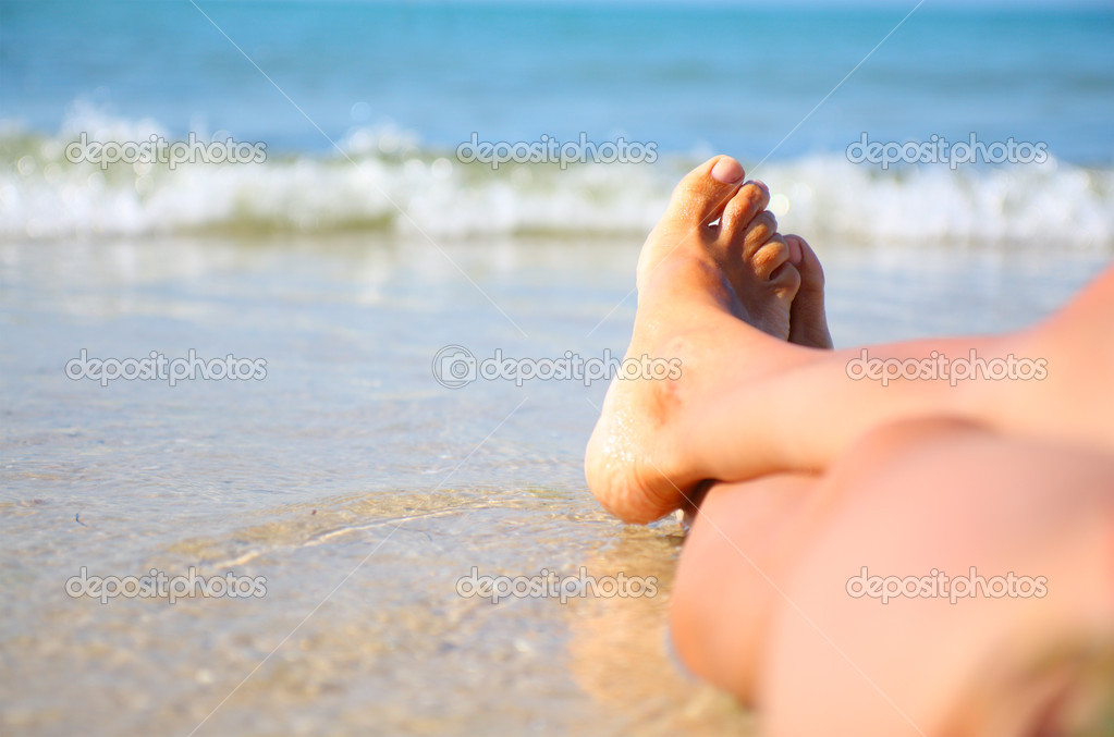 Woman's legs on the beach