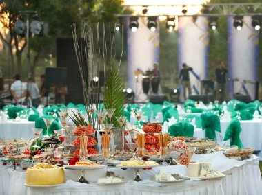 Covered table for a buffet table at the festival
