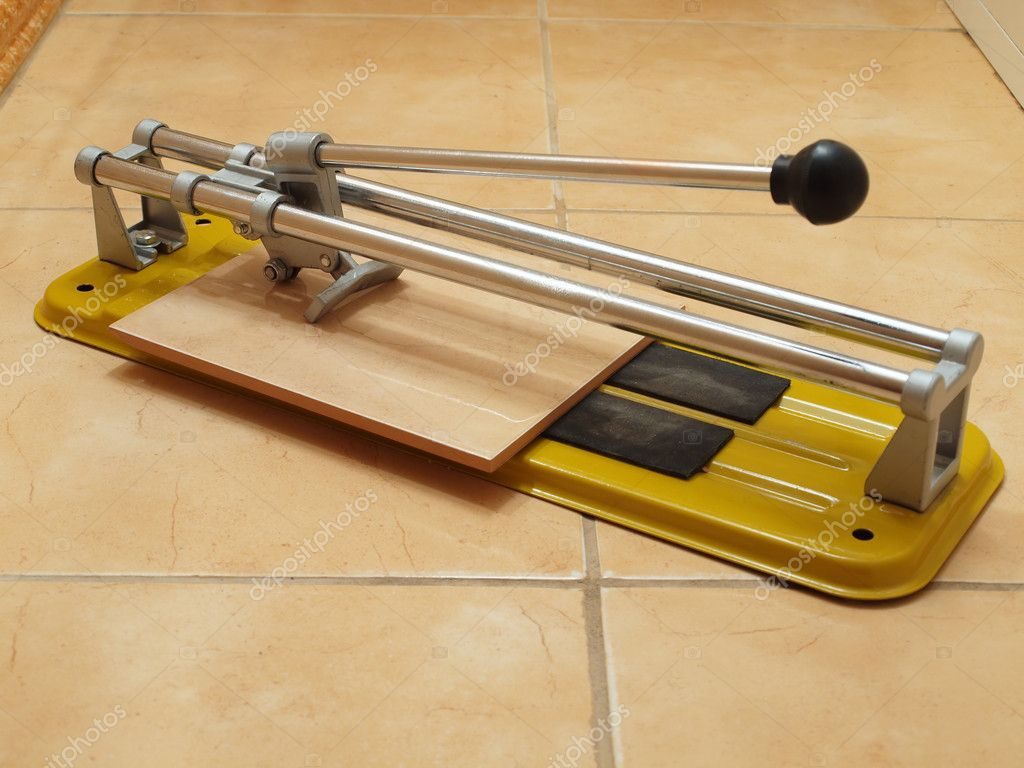 Ceramic tile cutter construction works ceramic tile cutter with tile stock photo dailygadgetfo Images