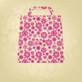 Růžové vánoční taška s zlaté vločky. EPS 8