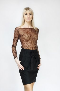 Beautiful blond woman in black mini skirt