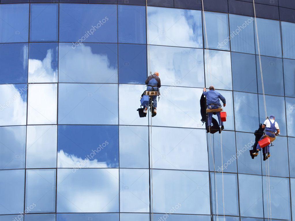 Workers washing a skyscraper windows