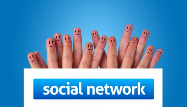 Group of finger smileys holding whiteboard with social network s