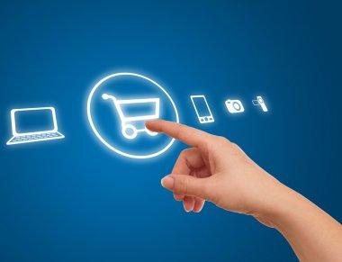 Hand choosing shopping cart symbol