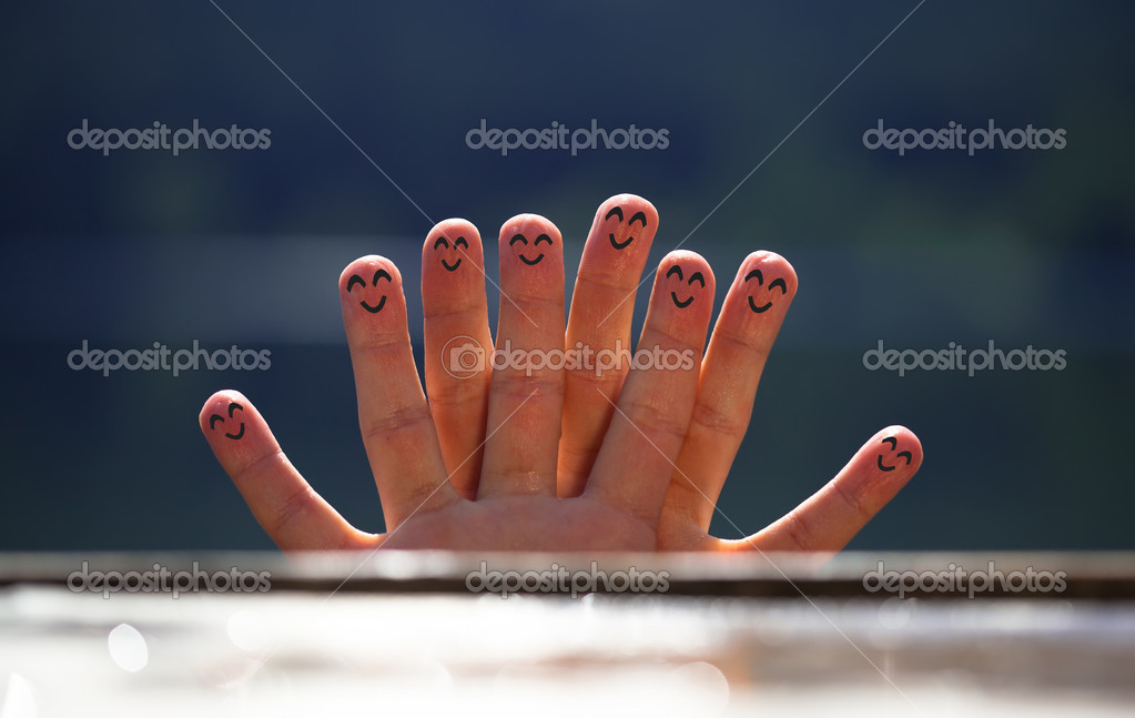 Group of happy finger smileys on the beach 5