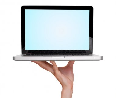Male hand holding a laptop