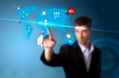 Businessman pressing social media button on digital map