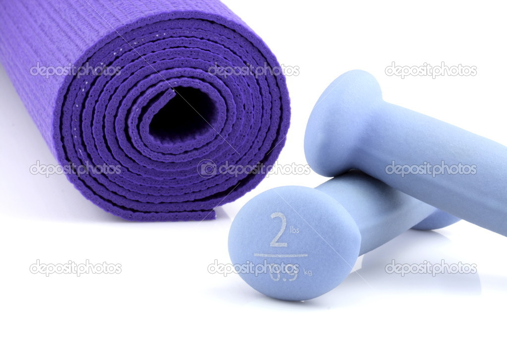 Set of women dumbbell weights and yoga mat