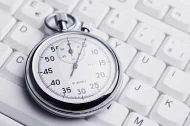 Stopwatch on white keyboard