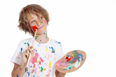 Child with paint brush planning mischief