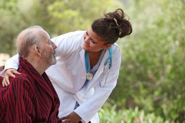 Nurse and patient home care (focus on man)