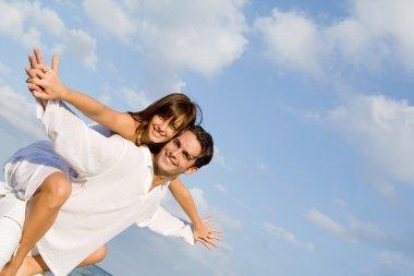 Happy couple on holiday vacation or honeymoon