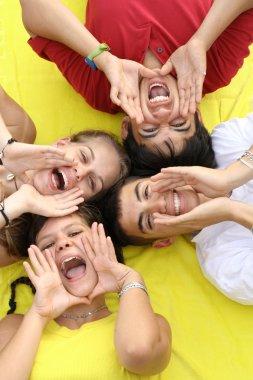 Group of happy teens shouting or singing