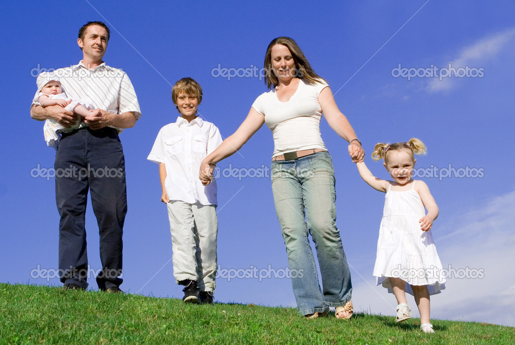 Happy young family parents and children