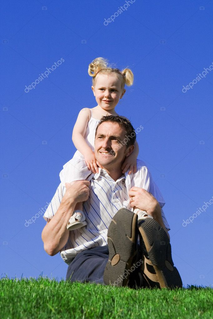 Family, father, and child playing outdoors