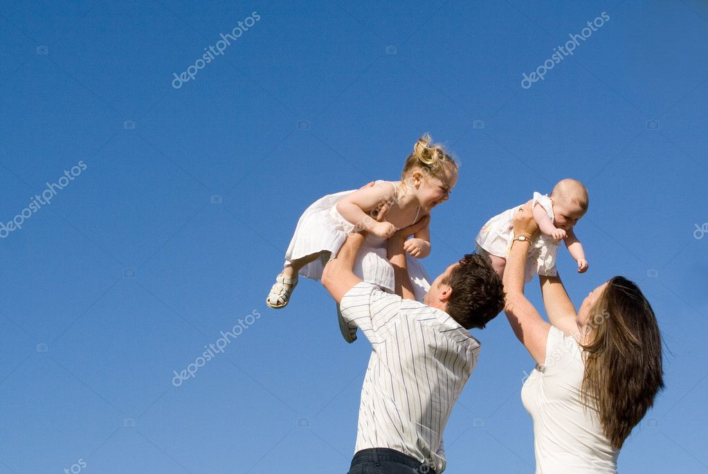 Happy family, parents and children