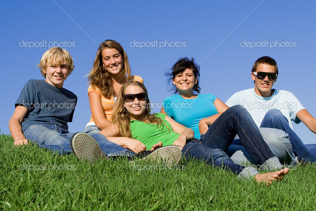 Group of happy teens or students in summer