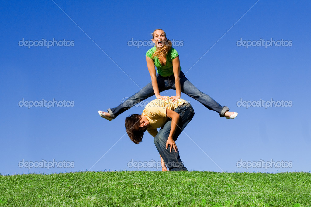 Active teens playing leapfrog
