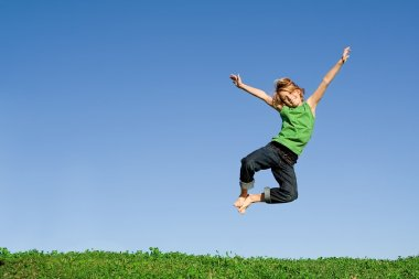 Fit healthy active happy smiling child, jumping for joy
