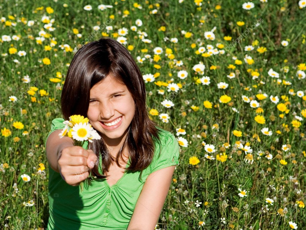 Happy smiling, summer child, holding flowers