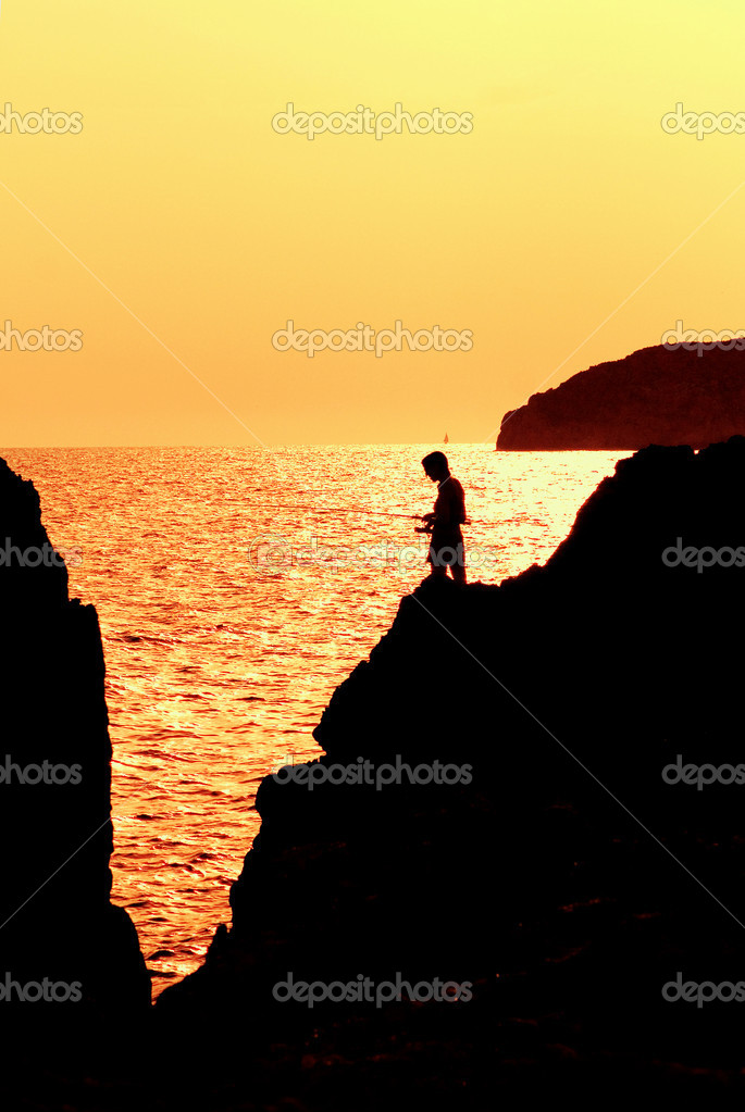 Fishing at dusk or dawn in mallorca spain