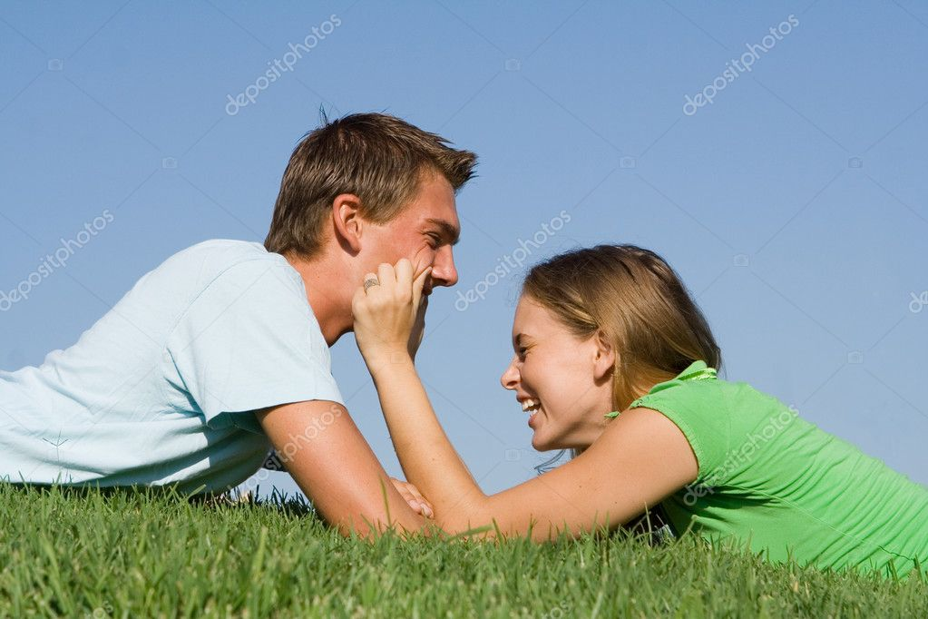 Happy young couple laughing having fun outdoors