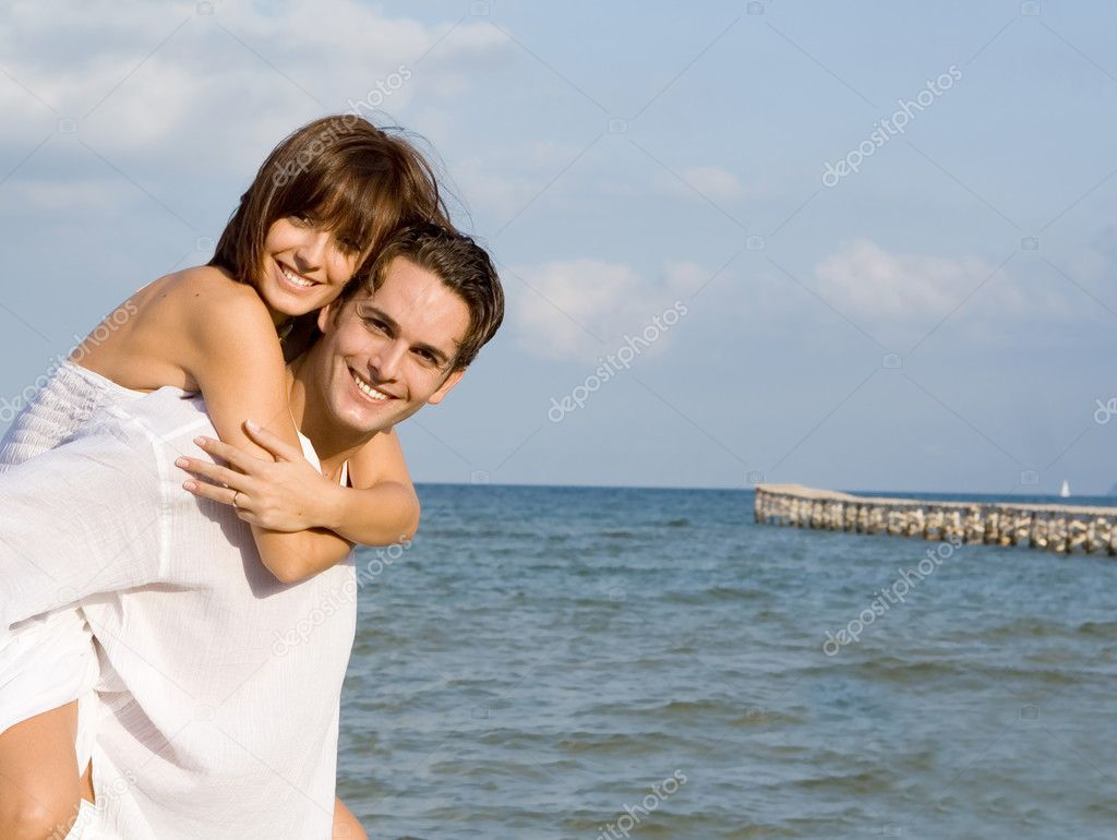 Happy Piggyback Couple On Summer Honeymoon Vacation Or -5949