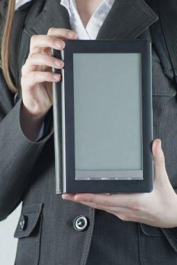 Girl holding an electronic book reader stock vector