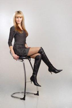 Beautiful blond sexy woman sitting on chair