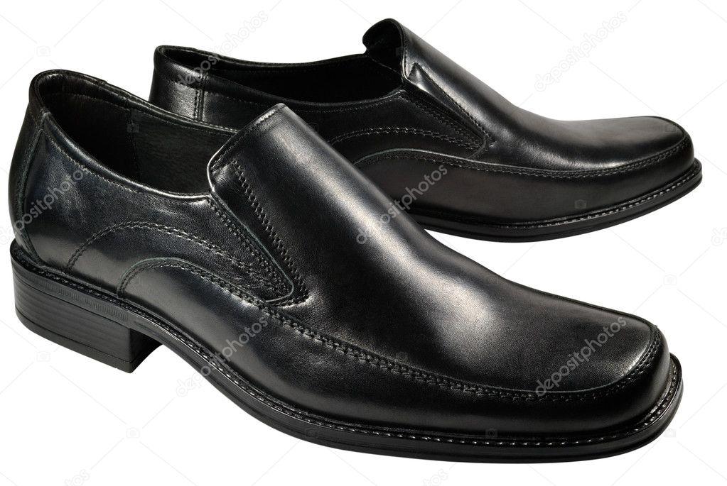 c24b5712d Sapatos masculinos clássicos feitos de cabedal preto. Isolado no fundo  branco — Fotografia por zhaubasar